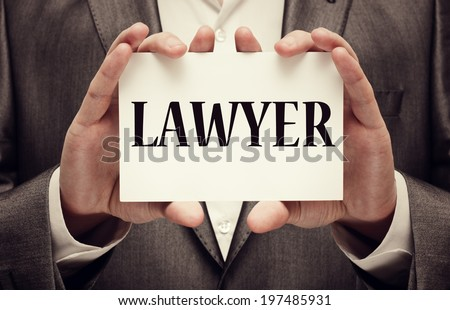 Lawyer. A man wearing a suit holding a signboard with the word lawyer written in it - stock photo