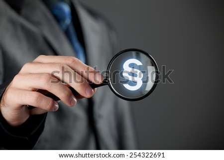 Lawyer (advocate, jurist) focused on protection of rights represented by paragraph symbol. - stock photo