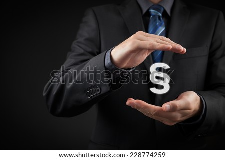 Lawyer (advocate, jurist) help protect rights. Law represented by paragraph symbol. Protection of rights and freedoms.  - stock photo