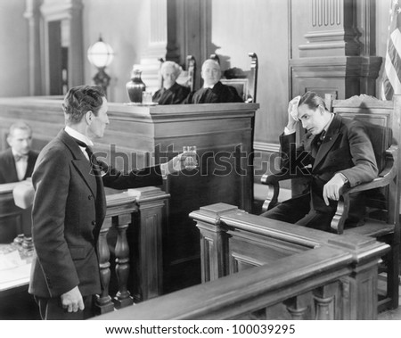 Lawyer and a witness in a courtroom - stock photo