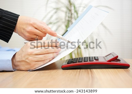 Lawyer and his client are examining legal document - stock photo
