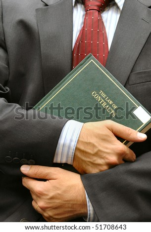 lawyer holding a book - stock photo