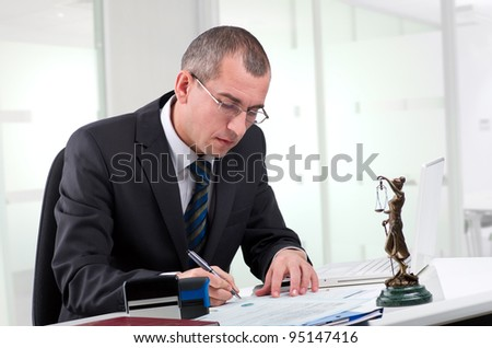 Lawyer on his workplace - stock photo