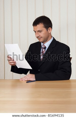 Lawyer or businessman studying a document or a contract