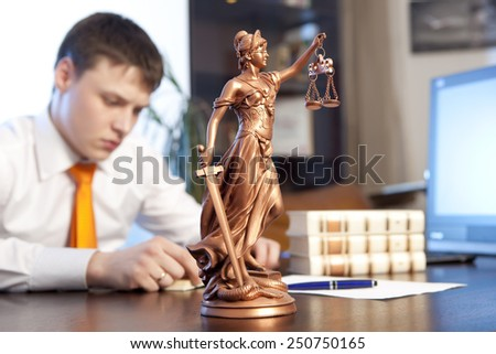 Lawyer reading a book in the office - stock photo