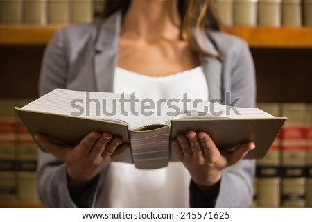 Lawyer reading in the law library at the university - stock photo
