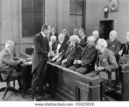Lawyer talking to jurors - stock photo