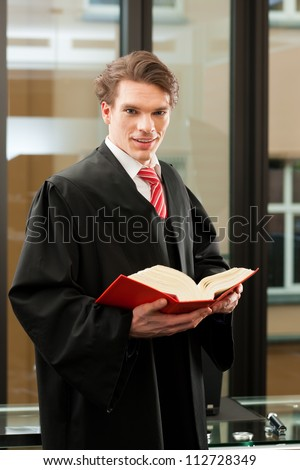 Lawyer with civil law code in a court room - stock photo