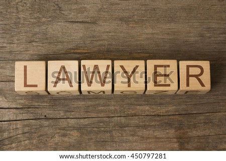 LAWYER word on wooden cubes - stock photo