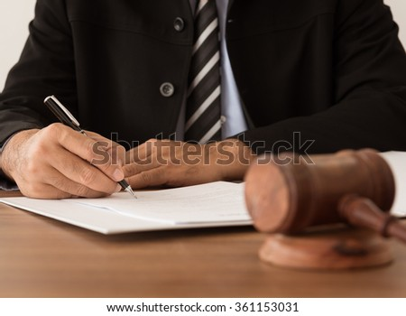 lawyer working at courtroom. - stock photo