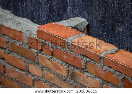 Lay Brick Wall, building brick wall. Selective focus.  - stock photo