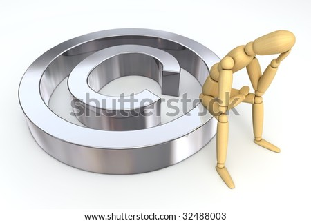 Lay Figure Sitting on Copyright Symbol - stock photo