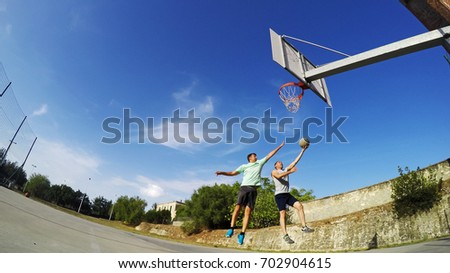 Lay up shot in a one on one basketball game