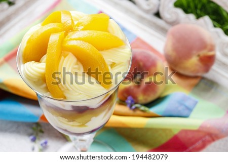 Layer fruit desserts on wooden tray. Summer garden party - stock photo