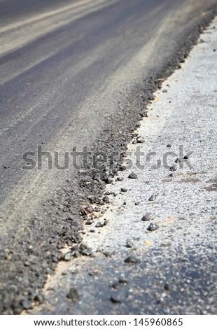 Layer of asphalt road in repair work. - stock photo