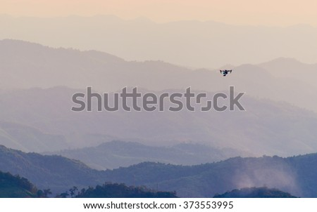 Layer of mountains and mist during sunset with drone - stock photo