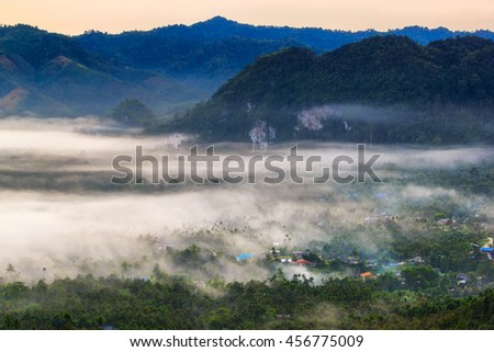 Layer of mountains in the mist at sunrise time, Baan Nai Wong, Ranong Province, Thailand - stock photo