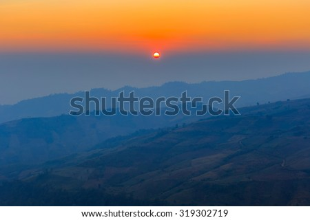 Layer of mountains in the mist at sunrise time In view panorama.edit warm tone - stock photo