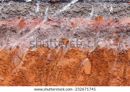 Layer of soil beneath the asphalt road.  - stock photo