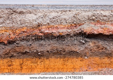 Layer of soil beneath the asphalt road - stock photo