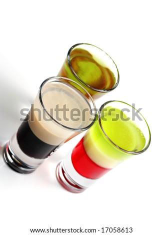 Layered Alcoholic Cocktails Isolated on White Background - stock photo