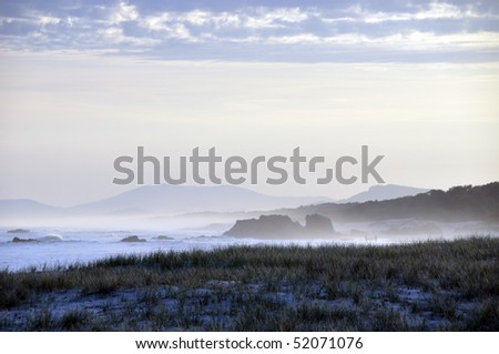 Layered Beach Landscape at Sunset - stock photo