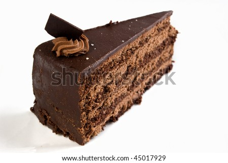 layered chocolate cake with ganache and butter cream filling