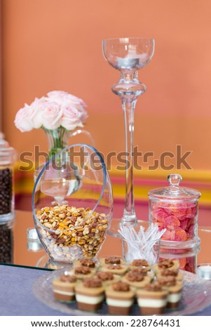 Layered dessert with fruits, in glass jar, selective focus, catering sweets - stock photo