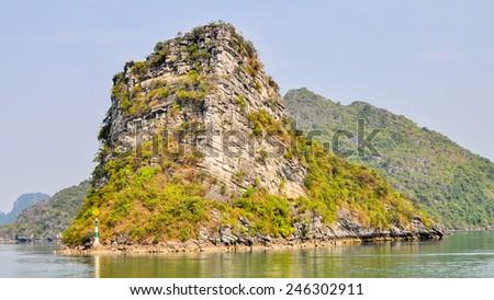 Layered Limestone Rock Promontory - Ha Long Bay, Vietnam - stock photo