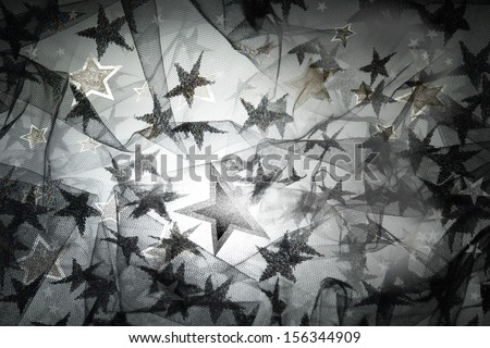 layered stars lace with a back light glow in silver and black - stock photo