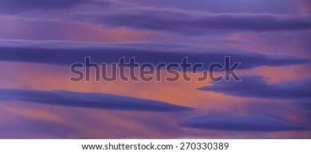 Layers of clouds at sunset with pastel colors