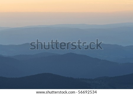 Layers of mountains at sunrise