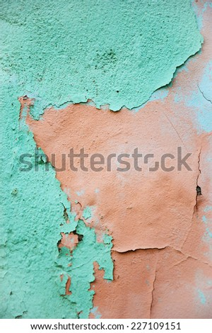 Layers of peeling paint on old house wall. - stock photo