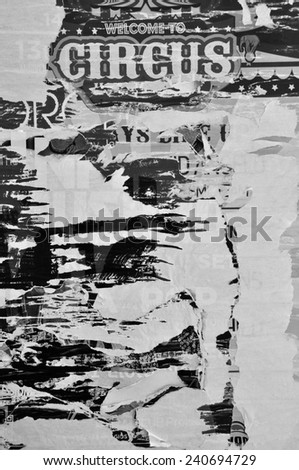 Layers of torn billboard posters abstract rough background texture. Black and white.