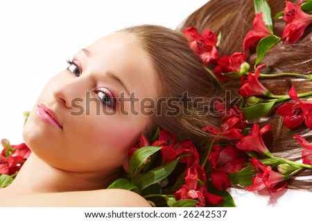 Laying beautiful  young woman with flowers
