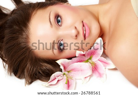 Laying beautiful young woman with lily flower