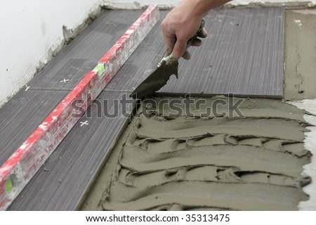 Laying Ceramic Floor Tiles In A Small Room - stock photo