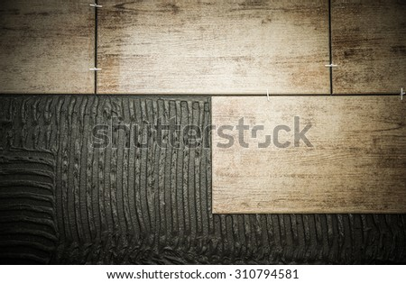 laying ceramic tiles on a special cement grout - stock photo