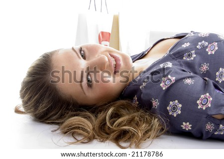 laying female with bags on an isolated white background - stock photo