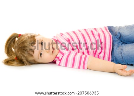 Laying funny little girl isolated - stock photo