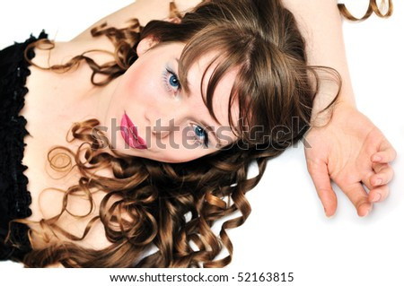 laying girl with wonderful hair over the white - stock photo