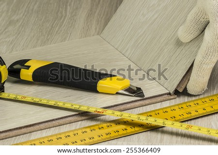 Laying laminate in the apartment. close-up - stock photo
