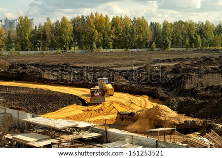 Laying of a new road on the outskirts of the city from above. - stock photo