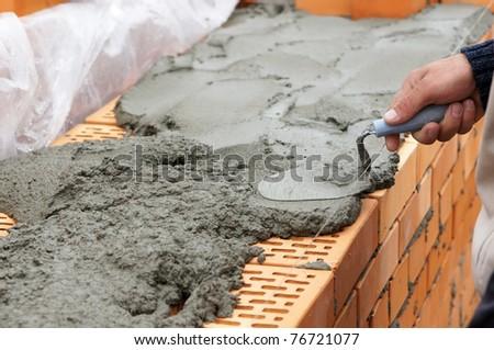 Laying of red bricks - stock photo