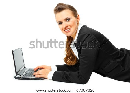 Laying on floor smiling modern business woman using  laptop  isolated on white