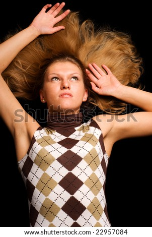 Laying on the black floor - stock photo
