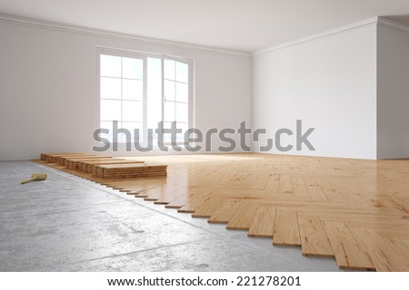 Laying out poplar hardwood in room in a house - stock photo