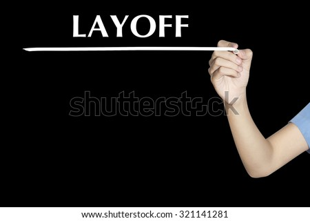 LAYOFF Woman writing word with black screen - stock photo