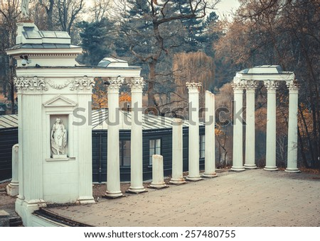 Lazienki Park with Roman inspired amphitheatre and Palace on the Water at the far end in Warsaw, Poland - stock photo
