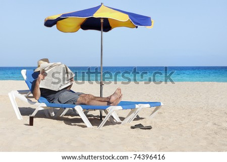 lazing man in sun lounger enjoying tranquil rest